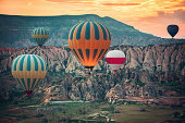 Hot air balloons flying over the valley at Cappadocia, Turkey.