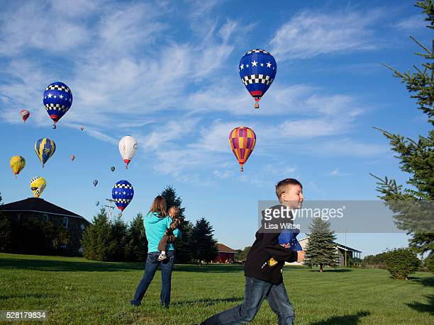 Hot Air balloons in the skies around rural Michigan near Battle Creek during the World Hot Air Ballooning Championships in Battle Creek Michigan USA...