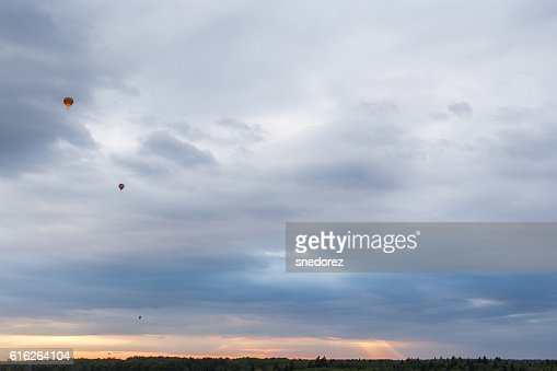 Hot air balloons in the sky at sunrise : Stock Photo