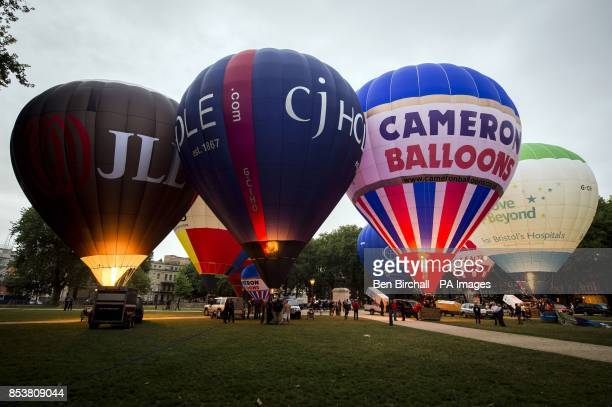 Hot air balloons inflate but remain tethered due to bad weather in Queen Square Bristol as balloonists from around the world gather this week to...