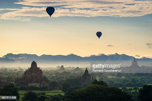 Hot air balloons over Bagan pagodas and monastery in a beautiful morning, Bagan, Mandalay, Myanmar