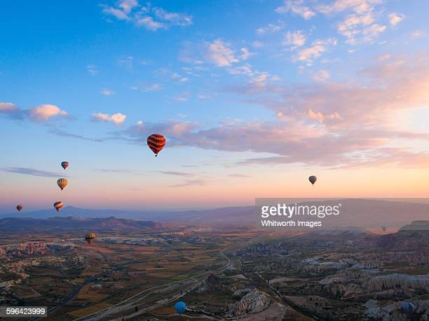 Hot air balloons over Cappadocia, Turkey at dawn