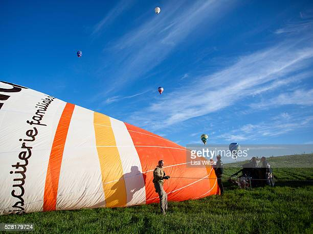 Hot air balloons prepare to launch in rural Michigan near Battle Creek during the World Hot Air Ballooning Championships in Battle Creek Michigan USA...