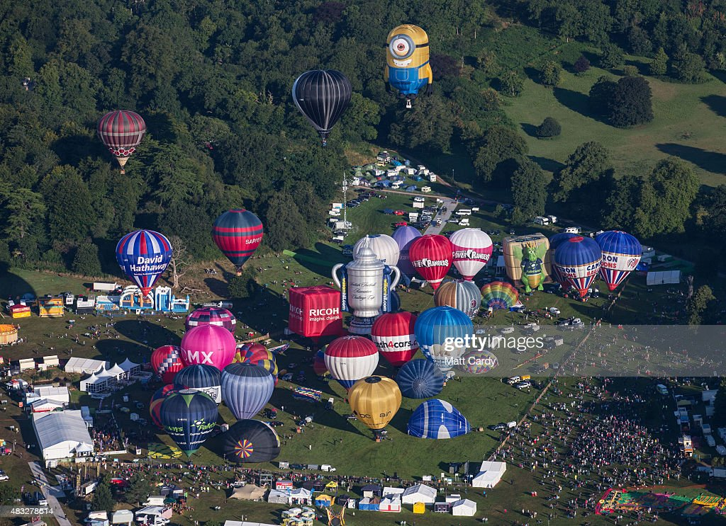 Hot air balloons rise into the morning sky from the Bristol International Balloon Fiesta main arena at the Ashton Court estate on August 7 2015 in...