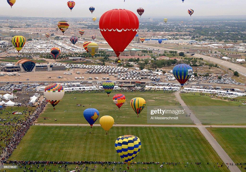 Hot air balloons soad above Balloon Fiesta Park during morning competition at the Albuquerque International Balloon Fiesta October 7 2005