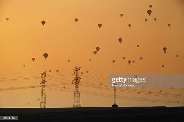 Hot air balloons take off on the sunrise at the Lorraine Mondial Air Balloon festival in July 1991 in Chambley near Metz France