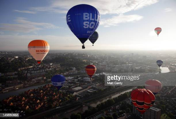 Hot air balloons take to the skies over Bristol city centre on August 6 2012 in Bristol England The early morning flight of over twenty balloons over...