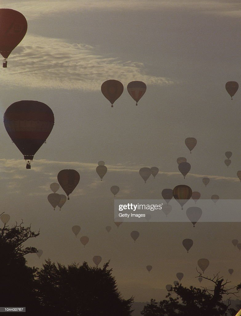 128 hot air balloons take to the sky in the then world record balloon lift at The Bristol International Balloon Fiesta on 15th August 1987 at Ashton...