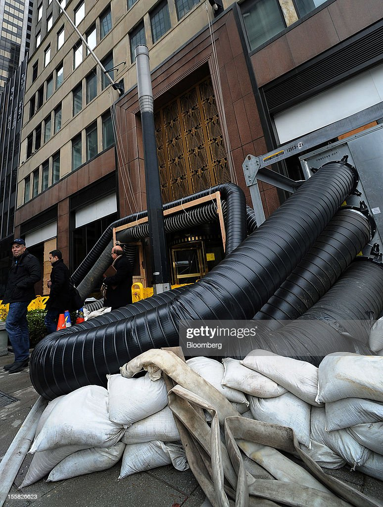 Hot air to dry water is pumped into a building at 120 Wall Street in the lower Manhattan area of New York, U.S., on Thursday, Nov. 8, 2012. New York-area residents shoveled several inches of snow and airlines prepared to resume flights as the region coped with a nor'easter that slowed the recovery from superstorm Sandy. Photographer: Peter Foley/Bloomberg via Getty Images