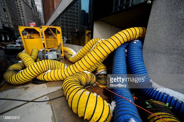 Hot air to dry water is pumped into a building at 125 Broad Street in the lower Manhattan area of New York US on Thursday Nov 8 2012 New Yorkarea...