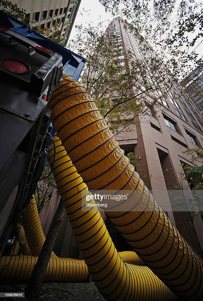 Hot air to dry water is pumped into a building at 75 Wall Street in the lower Manhattan area of New York, U.S., on Thursday, Nov. 8, 2012. New York-area residents shoveled several inches of snow and airlines prepared to resume flights as the region coped with a nor'easter that slowed the recovery from superstorm Sandy. Photographer: Peter Foley/Bloomberg via Getty Images