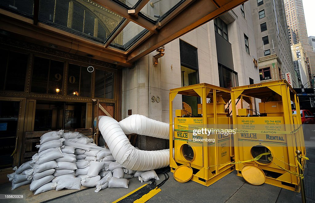 Hot air to dry water is pumped into a building at 90 Broad Street in the lower Manhattan area of New York, U.S., on Thursday, Nov. 8, 2012. New York-area residents shoveled several inches of snow and airlines prepared to resume flights as the region coped with a nor'easter that slowed the recovery from superstorm Sandy. Photographer: Peter Foley/Bloomberg via Getty Images