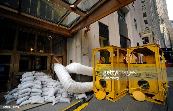 Hot air to dry water is pumped into a building at 90 Broad Street in the lower Manhattan area of New York US on Thursday Nov 8 2012 New Yorkarea...