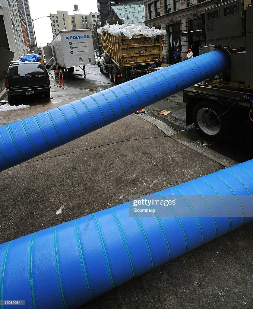 Hot air to dry water is pumped into a building in the lower Manhattan area of New York, U.S., on Thursday, Nov. 8, 2012. New York-area residents shoveled several inches of snow and airlines prepared to resume flights as the region coped with a nor'easter that slowed the recovery from superstorm Sandy. Photographer: Peter Foley/Bloomberg via Getty Images