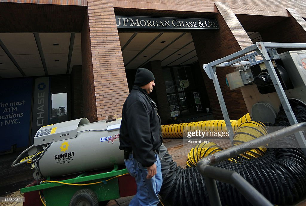 Hot air to dry water is pumped into a JP Morgan Chase & Co. bank branch in the lower Manhattan area of New York, U.S., on Thursday, Nov. 8, 2012. New York-area residents shoveled several inches of snow and airlines prepared to resume flights as the region coped with a nor'easter that slowed the recovery from superstorm Sandy. Photographer: Peter Foley/Bloomberg via Getty Images
