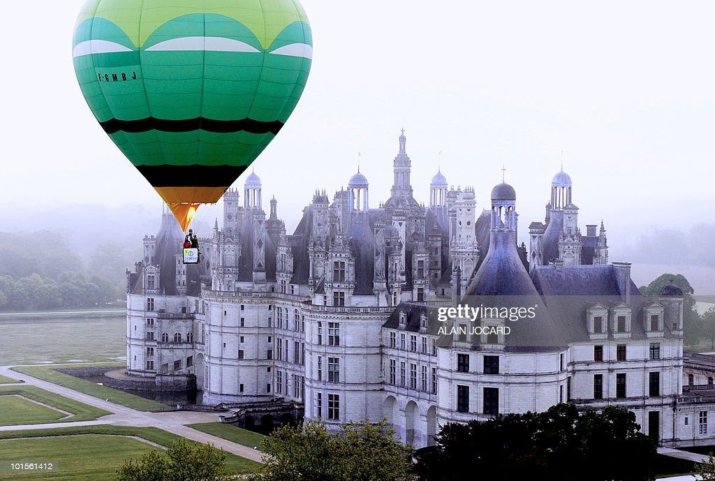 A hot air-balloon flies above the French Renaissance Chambord castle on May 15, 2010 in Chambord. Hot air-ballons drifted from May 14 to 16, 2010 in the Val de Loire skies during the fourth edition of the Montgolfiades de Loire 2010 event.
