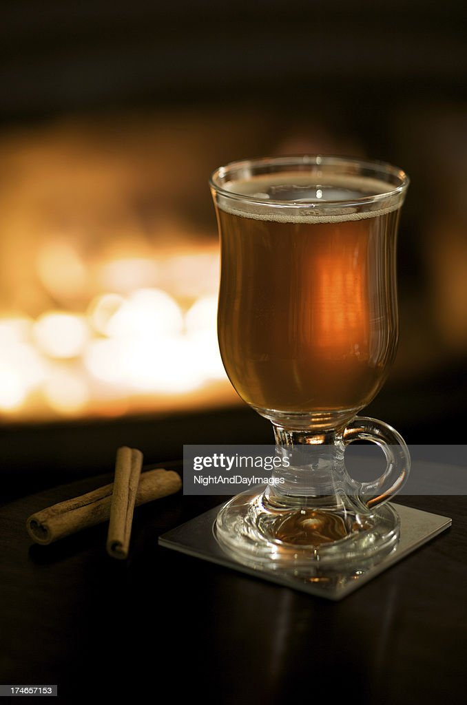 Hot Apple Cider by a Fireplace