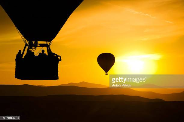 Hot balloon silhouette with sunrise sky background