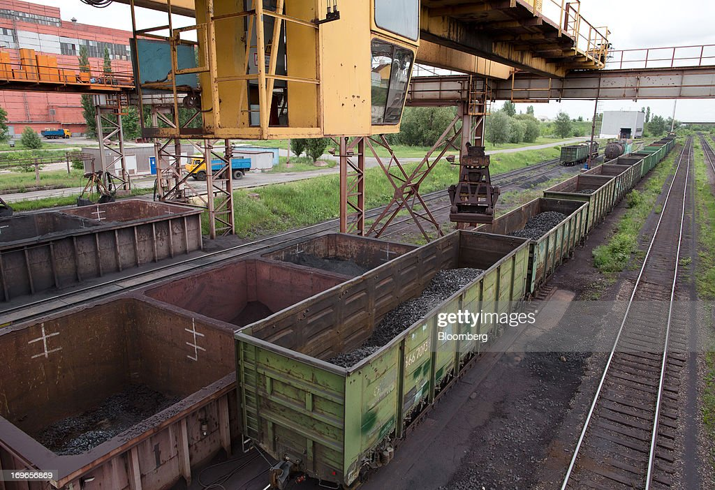 Hot briquetted iron (HBI) is loaded into freight wagons at the Lebedinsky GOK (LGOK) iron ore mining and processing plant, operated by Metalloinvest Holding Co., in Gubkin, Russia, on Tuesday, May 28, 2013. Lebedinsky, Russia's third biggest iron ore mine, is owned 81 percent owned by Russian billionaire Alisher Usmanov, who also owns Mikhailovsky GOK, Russia's second-biggest iron ore mine, and Oskol Electrometallurgical Combine, a steel plant supplied by Lebedinsky. Photographer: Andrey Rudakov/Bloomberg via Getty Images