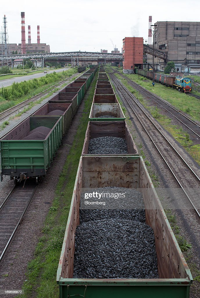 Hot briquetted iron (HBI) sits in freight wagons at the Lebedinsky GOK (LGOK) iron ore mining and processing plant, operated by Metalloinvest Holding Co., in Gubkin, Russia, on Tuesday, May 28, 2013. Lebedinsky, Russia's third biggest iron ore mine, is owned 81 percent owned by Russian billionaire Alisher Usmanov, who also owns Mikhailovsky GOK, Russia's second-biggest iron ore mine, and Oskol Electrometallurgical Combine, a steel plant supplied by Lebedinsky. Photographer: Andrey Rudakov/Bloomberg via Getty Images