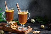 Hot buttered rum cocktail with cinnamon for Christmas and winter holidays. Homemade festive hot Christmas drink.