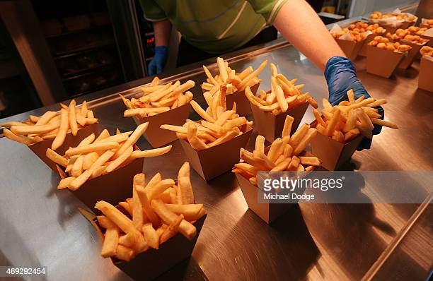 Hot chips are served during the round two AFL match between the Port Adelaide Power and the Sydney Swans at Adelaide Oval on April 11 2015 in...