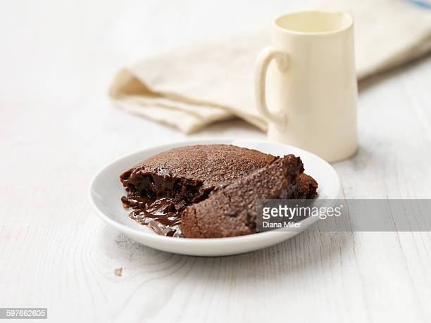 Hot chocolate fudge pudding on white washed wood