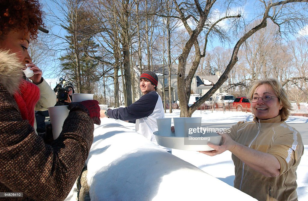 Hot chocolate is offered to reporters standing outside Martha Stewart's property in Bedford, New York on March 4, 2005. Stewart was released early this morning from federal prison in West Virginia after serving a five-month sentence for lying to regulators about a stock sale.