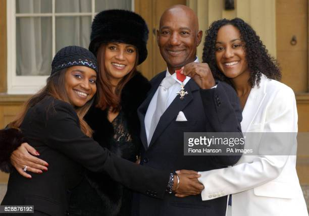Hot Chocolate singer Errol Brown with his wife Ginette and daughters Leonie and Colette after receiving an MBE for services to pop music from Queen...