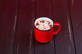 Hot chocolate with marshmallows on the black background