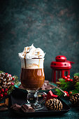 Hot chocolate with whipped cream with Christmas decorations