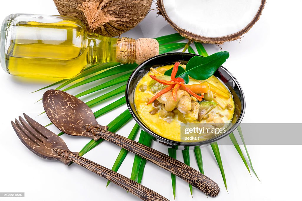 Hot coconut chicken soup with chili and curry : Stock Photo