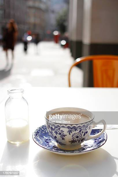 A hot cup of British tea is sat upon a white table