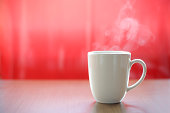 hot coffee or tea in the mug with real smoke ready to drink