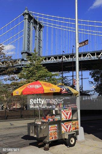 Hot dog cart with Manhattan Bridge