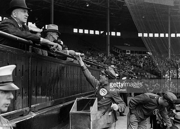 A hot dog seller at a Canadian baseball game