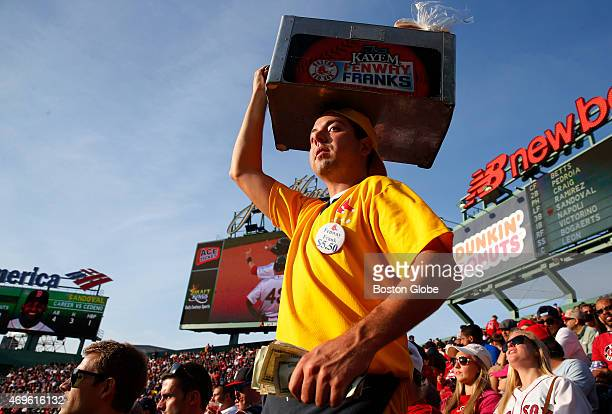 A hot dog vendor makes his way through the bleachers during the Red Sox home opener at Fenway Park in Boston on April 13 2015