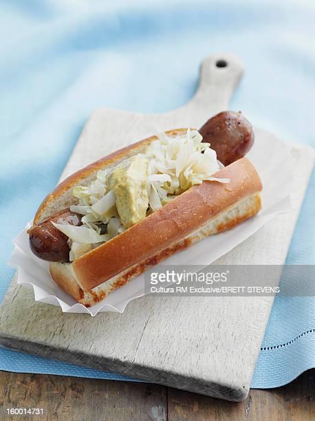 Hot dog with sauerkraut and mustard