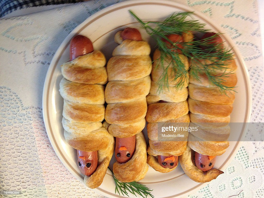Hot dogs wrapped in biscuit or crescent dough make great mummies.