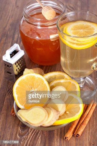Hot ginger lemon tea, honey and cinnamon : Stock Photo