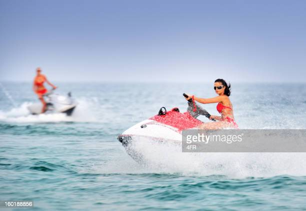 Hot Girls on Jet Skis / Waverunner in tropical Water
