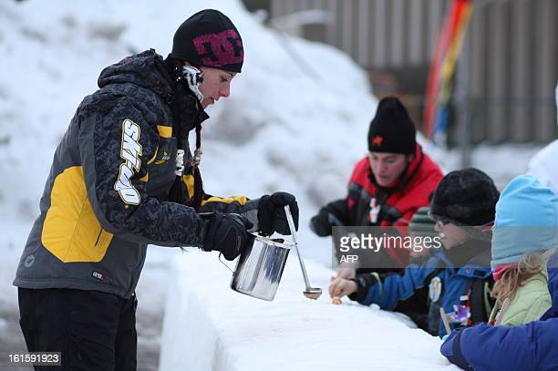 Hot maple sugar tasting takes place during carnival in Quebec City on February 10 Canoe Races snow baths sliding on tubes dog sledding hockey table...