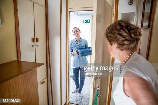 Hot Meal Delivery to an Elderly Woman at Home : Stock Photo