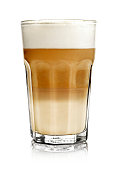Hot milk coffee or latte macchiato glass, isolated on white. Italian coffee with milk and layers. Gourmet coffee.