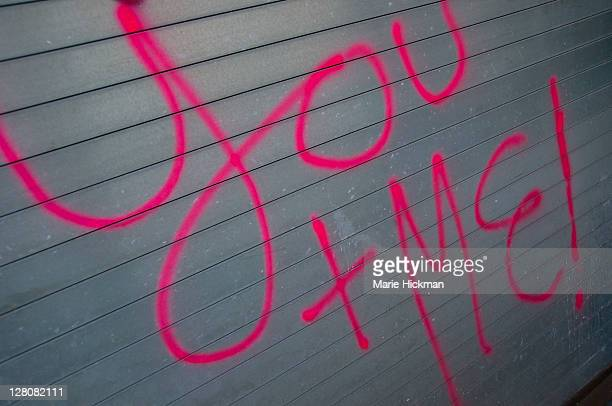 Hot pink Graffiti 'You + Me' on a grey metal background, Chelsea, New York