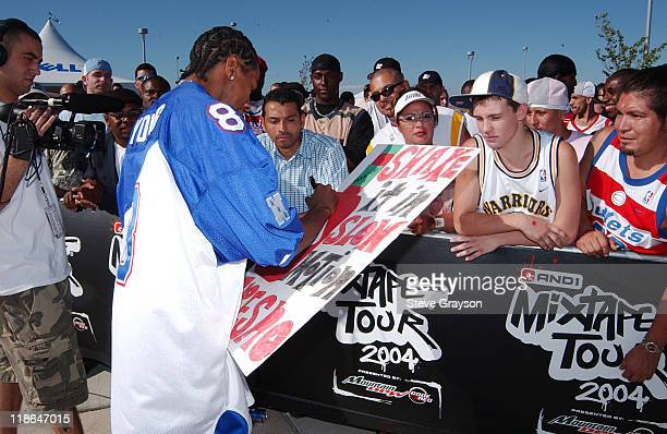 Hot Sauce signs a poster for fans who came out to see Street Ballers from Fresno California and surrounding areas put on their best game to play with...