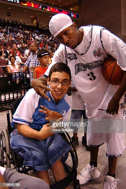 Hot Sauce takes time out to pose with a fan during the 2004 AND1 Mix Tape Tour stop at Orleans Arena in Las Vegas Nevada June 16 2004