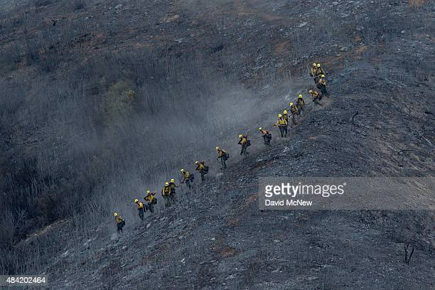 A hot shot crew descends a scorched mountainside at the Cabin Fire in the Angeles National Forest on August 15 2015 north of Azusa California The...