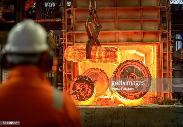 Hot steel castings in furnace of steelworks