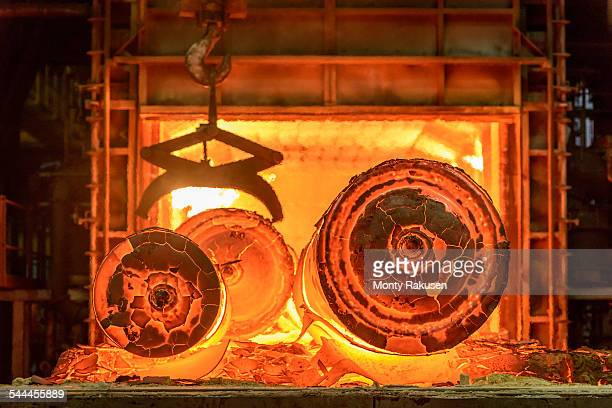 Hot steel castings in furnace of steelworks